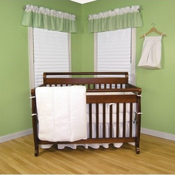 """Trend Lab - Pique Four Piece Crib Bedding Set in White - Classic and charming, waffle pique can be combined with any existing home dcor to create a fresh and traditional feel for your baby's bedroom, nursery or play space. This four piece crib bedding set includes all the necessities for your baby's crib: a crib quilt, bumper, sheet, and skirt. Choose other items in the White Pique Collection to make a complete room. Features: -White -Waffle pique -Includes Crib quilt, bumper, sheet and skirt -Crib Skirt has ruffled style -Crib Sheet is 100% deluxe cotton jersey in White with 10"""" deep pockets -Available separately in Pink, Blue and Sage Green gingham seersucker"""