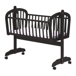 DaVinci - Futura Rocking Cradle with Wheels - Swing your little one in this contemporary Futura Cradle with casters. Metal support under the bottom panel as well as a locking pin, provides this cradle with added security that keeps your baby safe. Features: -Metal support under bottom panel.-Locking pin.-1'' Pad included.-Constructed from New Zealand Radiata Pine Wood.-Actual color may vary slightly from shown.-About New Zealand Radiata Pine Wood: Radiata Pine, better known as 'New Zealand Pine' is a softwood tree that contains many properties that make it very suitable for furniture and furniture making. It has a density equal to that of hardwoods like poplar, mahogany and oak. Its uniform density ensures a smooth and consistent texture and confers its excellent machining, painting and staining properties; there is almost no variation in color between pieces. DaVinci's pine wood originates from forests maintained by managers that enforce environmental responsibility and the conservation of forest wildlife. ***Please note that these products cannot be shipped to Alaska, Hawaii, or Puerto Rico. We apologize for the inconvenience - feel free to call us regarding alternatives!.-Collection: Futura.-Distressed: No.Dimensions: -Pad: 1'' H x 18'' W x 36'' D.-Overall: 36'' H x 22.5'' W x 39'' D.