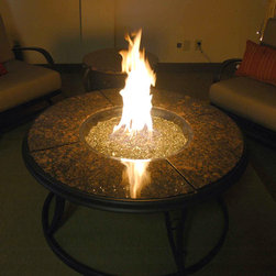 """42"""" Granite Fire Pit Table with Crystal Fire - With a beautiful crystal bed to reflect a dancing fire, the 42"""" Granite Fire Pit Table with Crystal Fire is a great addition to an outdoor or patio area. -Mantels Direct"""