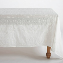 "Origin Crafts - White embroidered voile tablecloth 70x108 - White Abstract Embroidered Voile Tablecloth 70x108 Sheer and fine, our cotton voile cloth floats over the table like mist, letting the beauty of the tabletop show through. The look is ethereal over glass, earthy over wood, and iridescent over a colored under-cloth. Hand-stitched embroidery punctuated with nubby French knots offers a hint of pattern and texture. Cotton is 100% organic, and sourced and woven in India. Dimensions (in):70"" x 108"" By Coyuchi - Coyuchi was founded 20 years ago in Point Reyes Station, a small, rustic town on the Northern California coast. There, surrounded by ocean and forest, beach and bluff, we created a line of home textiles rooted in nature. Our signature bedding, made from 100% certified organic cotton, soon earned a loyal following among people who nurture a connection to the natural world in their lives and in their homes. Ships within Five Business Days."