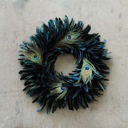 Midnight Flock Feather Wreath - A rich teal wreath with peacock feather accents is a beautiful touch of chic and luxe. The broad wreath of textural feathers adds instant seasonal sophistication to any room. Draw long admiring glances, wherever you showcase the Midnight Flock Feather Wreath.