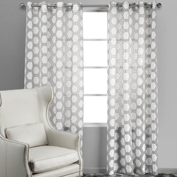 Ankara Panel, Gray - I love how these curtains won't block any precious sunlight and add so much visual interest to the room. I think they would look great with a bright wall color.