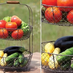 Two Tier Wire Basket - Keep your space clutter free and organize your tight space with this two-tiered wire basket. Whether you fill it with lemons and oranges to create a lovely centerpiece, or you keep your tools, brushes and craft tools in your home office, you will love how simple and chic this basket is.