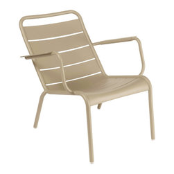 Fermob - Luxembourg Low Armchair - This modern outdoor chair offers a great way to relax in any outdoor space. Perfect for eating and drinking in the sun, or just chatting with others in a comfortable environment. It is stackable and comes in many beautiful colors.