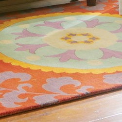 Medallion Rug - On-trend red, aqua and orange rug is fashion for your floors. Distinctive medallion design is a centerpiece for any room that demands a soft, thick rug underfoot. Hand crafted of 100% tufted wool.