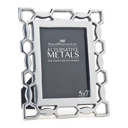 "Philip Whitney - Pierced Aluminum Frame, 5""x7"" - Add instant elegance to your desk and bookshelves using the 5-by-7 inch Pierced Aluminum Frame. This frame's smooth silver surface and geometric, honeycomb-like design give it a simple, polished look that pairs well with transitional decor."