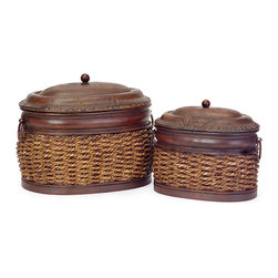 None - Rattan and Iron Delhi Nesting Boxes - These boxes come in a Delhi style perfect for any decor. Handmade by Chinese artisans of rattan with iron tops, these oval boxes will provide stunning beauty and use to any room.