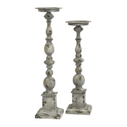 Imax Worldwide Home - 2-Pc Candle Holders - Includes small and large candle holders. Holds pillar candles. Made from 100% wrought iron. Small: 6 in. Dia. x 22.5 in. H. Large: 6 in. Dia. x 25.75 in. H. Weight: 7.8 lbs.These aged iron candleholders have a subtle overstated simplicity that makes the Hamilton candleholders look great in a variety of settings.