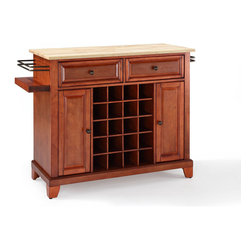 Crosley Furniture - Crosley Furniture Newport Natural Wood Top Wine Island in Classic Cherry - Wine lovers will entertain in style with Crosley's Kitchen Wine Cart.  Whether you're a connoisseur of fine wines or simply a casual fan, Crosley's Kitchen Wine Cart offers the utmost in entertaining convenience.  The cabinet features a 20-bottle wine rack and side-mounted 3-bottle wine valet and the top provides ample surface space for presentation of your wine and cheese alike. Raised panel doors conceal the adjustable inner shelving and two sliding drawers provide several options for storage. Wine cabinets come in one of four signature Crosley finishes featuring one of four surfaces - including wood, stainless steel or solid granite.