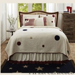 American Parade Quilted Bedding - Handmade yo-yo work is a homespun classics - here the sizes are varied and placed randomly for an updated take on patriotic decor. Echo quilting around each yo-yo is hand stitched. Quilt reverses to cream solid with red binding. American Parade Quilted Bedding features embedded yo-yos in red, navy & khaki fabrics on a cream flax cotton base with echo quilting,  100% cotton shell and fill.