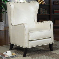 Accent Seating Wing Accent Chair with Nailhead Trim - Featuring nailhead trim, tapered wood legs, and a white faux animal print across the whole chair, this unique chair is a smart furniture choice for your home.