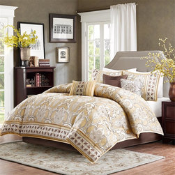 Madison Park - Madison Park Chapman 7 Piece Comforter Set - Chapman�۪s sophisticated design features an intricate print in neutral tones of taupe and beige and a brown geometric print on the bottom of the comforter. Beige piping runs along the border to create a finished edge. This comforter set includes two king shams and three beautifully embroidered decorative pillows. Comforter & Sham: 100% polyester jacquard pieced, 100% polyester brushed fabric reverse Filling: 270g/m2 polyester Bedskirt: 100% polyoni drop, polyester platform Pillow: 100% polyester shell, polyester filling