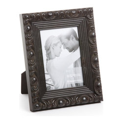 """Origin Crafts - Vintage black wood picture frame - Vintage Black Wood Picture Frame Amongst the twenty arrondissements or districts that make up Paris there is a former fortress which stands proud as the focal point of district number one ? the Louvre. A majestic masterpiece where priceless art is encased in classic elegance, founded in the spirit of authentic French tradition. It was here in the Louvre, inspired by its magnificence and contribution to modern culture that Vintage was born. Dimensions (in): Width: 2, Height: 1 1/4 Holds (4""""x6"""", 5""""x7"""", 8""""x10"""") photos. By Roma Moulding - Roma Moulding uses only the highest quality materials. Roma owes it?s renown to exquisite details: meticulous applications of gold and silver leafing, genuine woods, exotic veneers, patinas, superior lacquers and finishes all done by hand. Roma employs time proven techniques to achieve the stunning finishes other manufacturers strive to achieve. Ships within Five Business Days."""