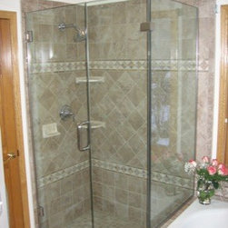 """Framless Return Shower Doors with Knee Walls - Picture perfect! ½"""" glass with brushed nickel hardware. This style of enclosure is one of the most common styles but explodes with the simple elegance of functional yet beautiful."""