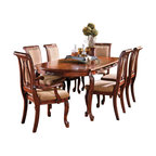 """Steve Silver Furniture - Steve Silver Harmony 7-Piece Oval Dining Room Set in Cherry - Intricate Georgian-style carvings give the Harmony dining collection an antique feel, adding warmth and formality to any dining area. The 42""""W x 66""""-84""""L x 30""""H table has a Cherry finish and carvings decorating the edge of the tabletop and the legs. This stunning piece comfortably seats six when the removable 18"""" leaf is in place."""