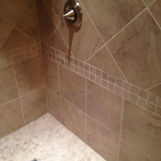 Eclectic Tile by Total Quality Home Builders, Inc.