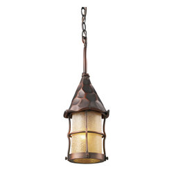 Elk Lighting - Rustica 1-Light Outdoor Pendant in Antique Copper and Amber Scavo Glass - Bring storybook flair to an old english, cottage or spanish revival-style home with the Rustica Collection. Hand-hammered iron and scavo seedy-glass cylinders characterize this series, which may be ordered in matte black (bk) with white scavo glass and antique copper (ac) with amber scavo glass. They may be used in both indoor and outdoor locations. (ul listed).