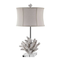 Stein World Siesta Key Table Lamp - You don't have to dive deep for the perfect table lamp - it's right here in the Stein World Siesta Key Table Lamp. Crafted with a durable resin base carved to look like craggy coral and finished in a soft ivory hue, this sea lover's lamp is topped with an elegant drum-shaped off-white shade. A three-way socket switch lets you easily adjust light levels. Requires one 100-watt bulb (not included).About Stein WorldStein World is dedicated to discovering and bringing to the marketplace the finest hand-painted products from around the world. With over 50 years of experience, they have been able to develop not only the resources but true partnerships with quality manufacturers and artisans who make Stein World unique in the furniture industry today. Their commitment to you is to present only the highest quality furniture at prices that bring future family heirlooms into everyone's price range.