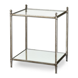 Gannon End Table - The sleek and sublime Gannon End Table displays mid-century modernism and metropolitan cool. The forged iron frame glimmers in antique silver leaf and holds a clear, tempered glass top and mirrored gallery shelf. A striking accent piece for your home, the table allows for the display of collectibles, ephemera, and favorite tomes.