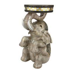 "Oriental Furniture - 20"" Sitting Elephant Statue - A beautiful accent piece for your home, this decorative table depicts a trained Indian Elephant. Sitting on its back while carefully balancing a disc above its head, this elephant wears a delicately carved wedding costume in traditional style. Expertly painted and cast in high quality resin, this fetching table is sure to delight your guests and add a playful, exotic touch to your home decor."