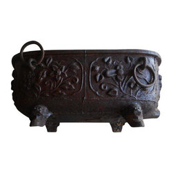 Pre-owned 19th C. Iron Chinese Bathtub - This gorgeous cast iron Chinese bathtub dates back to at least the late 19th century if not older. There are three distinct markings: the first one can't be translated (as they used archaic Chinese), the 2nd marking is the location where the bathtub was made and the 3rd is the name of the maker. As you can imagine, this piece is very heavy (over 200 lbs) and takes at least two people to move. The previous owner had a piece of beveled glass made to use this as a coffee table - use your imagination with this unique Asian antique.