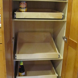 Pantry Roll Out Shelves - Create an organized pantry with custom pull out shelves from ShelfGenie of Portland, designed to fit your existing space.  Increase your ability to see and reach stored in your pantry, ultimately saving you time and money.