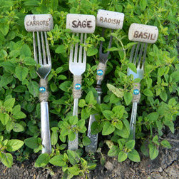 Vintage Sterling Silver & Silver-Plated Fork Plant Markers by Varleys Vintage - This set of markers is made with vintage sterling silver forks and knives topped with wine corks with the herb names written on them. You could make your own at home!