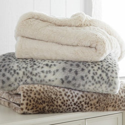 Fur Throw - Add another layer of winter warmth with our supersoft throw that displays snow leopard markings.