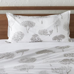 "Marimekko Rantapuisto Grey King Sham - Global forest plants grey silhouettes of the world's trees on crisp white cotton percale bedding, artfully rendered in designer Fujiwo Ishimoto's painted design. Inspired by his observations of nature in many settings, the pattern is named Rantapuisto, a Finnish word meaning ""beach park."" Sham has a 1"" flange and generous overlapping back closure. Bed pillows available."