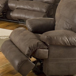 Catnapper - Ranger 379 Glider Recliner in Chocolate - Faux leather fabric. Attractive sewing details highlighted w double needle stitching. Features glider mechanism. Unitized steel base. 100% Steel seat box. No warping or splitting in this critical area (standard on most models). Reclining Mechanism:. Installed with noiseless sure-lock spring clips. Strongest recliner seat box available. Direct drive cross bar ensures that both sides of the mechanism operate together, in sequence, for longer life. Heavy 8-gauge sinuous steel springs in the seat provide strength, comfort and flexibility. Made of 100% polyester. Cleaning Method:. Clean only with water-based shampoo or foam upholstery cleaner. Do not over wet. Do not use solvent. Do not saturate with liquid. Pile fabrics may require brushing to restore appearance. Cushion covers should not be removed and laundered. No assembly required. Limited lifetime warranty. 43 in. L x 40 in. W x 42 in. H (110 lbs.)