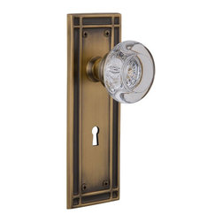 Nostalgic Warehouse - Nostalgic Mission Plate with Round Clear Crystal Knob and Keyhole, Antique Brass - The Mission plate in antique brass harkens to the Spanish Colonial period of the Western frontier, with an instantly recognizable square corner. Adding our Round Clear Crystal Knob, which features a circular shape that magnifies the beautiful facets underneath, only serves to bring the past alive. All Nostalgic Warehouse knobs are mounted on a solid (not plated) forged brass base for durability and beauty.