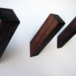 MUCHroom Wall Hook - I love these simple hooks. They're made of pretty hard wood and look like they're growing out of the wall.