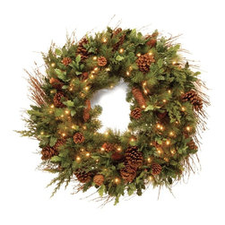 National Christmas Products Inc - 30 in. Decorative Collection Juniper Mix Pine Pre-Lit Wreath - Clear Lights Mult - Shop for Holiday Ornaments and Decor from Hayneedle.com! Loaded with pine cone accents in a variety of sizes the 30 in. Decorative Collection Juniper Mix Pine Pre-Lit Wreath - Clear Lights creates a beautiful welcome for your holiday guests. Lit by 100 clear mini bulbs this wreath casts a soft white light from your front door.Don't Forget to Fluff!Simply start at the top and work in a spiral motion down the tree. For best results you'll want to start from the inside and work out making sure to touch every branch positioning them up and down in a variety of ways checking for any open spaces as you go.As you work your way down the spiral motion will ensure that you won't have any gaps. And by touching every branch you'll create the desired full natural look.National Tree Company warrants its trees against manufacturer-only defects in material or workmanship for a period of five (5) years. White trees and shrubs are warranted against manufacturer defects for one (1) year. Light sets on pre-lit trees are warranted against manufacturer-only defects in material or workmanship for two (2) years. Fiber optic trees are warranted against manufacturer-only defects in material or workmanship for ninety (90) days.Manufacturer defective parts will be repaired or replaced. PROOF OF PURCHASE IS REQUIRED and will include item number UPC code and a copy of dated sales receipt with store name noted. Keep products away from heat and moisture. Limited warranty does not cover damage caused by accident misuse abuse negligence or normal wear.For more warranty information or to make a claim please contact National Tree Company at service@nationaltree.com or 1-888-494-PART.