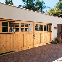 Carriage Garage Doors - Knotty alder, outswing carriage doors by Real Carriage Door Company.