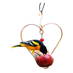 Songbird Essentials - Love Birds Fruit Feeder - This two spiral fruit feeder companion for our popular Love Birds Jelly Feeder has 2 red glass bead dangles that decorate this stylish heart-shaped feeder.