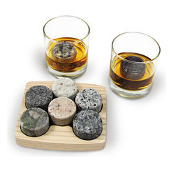 """Sea Stone On the Rocks Drink Chillers Gift Set - A great gift idea, our On the Rocks Drink Chillers Set will make every bar complete. Based from an idea that originated in Scotland years ago to eliminate watered-down drinks from melted ice, our drink chiller set is functional, fashionable, and original. Made from stones collected in New England rivers. Each set features the perfect sized glasses for drinking """"on the rocks."""" Boasting a classic look and an elegant feel, our Bambeco Classic Glasses are handmade from recycled clear glass, are gently rounded at the base, and have thicker shams for greater weight and stability.Set Includes: Drink Chiller Set of six chillers and two 8 oz glasses.Care: Dishwasher safe."""