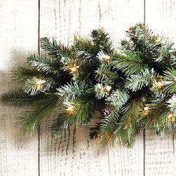 Ballard Designs - Ballard Classic Prelit Wreath - Pre-lit with dozens of white lights. Tuck in your own berries for pops of color. Also available in unlit styles. Forever green, forever full and forever in style, our classic pre-lit greenery is the start of every beautiful holiday season. And it's so well priced, you can deck the halls from floor to ceiling. Hand crafted with soft synthetic needles and accented with real pinecones for a lush natural look.Ballard Classic Greenery features:. . .