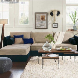 """Viva Terra - Eco Sectional with Navy Stripe Cushions and Left Arm Chaise - We spent five years looking for a sectional that combined comfort, practical styling and eco-friendliness. Our search came to a satisfying end when we kicked back on this all-green, all-purpose rare find. First, the eco lowdown: Our manufacturer uses only certified sustainable wood frames and water-based wood finishes, recycled fiber filling in the pillows, and soy-based filling in the cushions. Upholstered in 100% linen ticking with tufted buttons - materials that are as durable as they are mindful - cover our sectional.Next, the comfort factor: We sat, we stretched and we were conquered - this is the curl-up sectional of all times. The frames are made from select kiln-dried hardwoods. Joints are double-doweled, and every corner is blocked, screwed and glued so that there are no creaks or sags.And the coup de grâce: The two cushions of our sectional (a one-armed couch plus chaise) are each the size of a twin mattress - remove the back pillows and sweet dreams are guaranteed. Made in USA. COUCH 79""""Wx42""""Dx32""""H, CHAISE 42""""Wx79""""Dx32""""H. Note: $150 shipping surcharge applies. Allow 8 weeks for delivery, see shipping info. IMPORTANT: when you are standing facing the sectional, a right-arm sectional has the chaise on the right and a left-arm has the chaise on the left."""