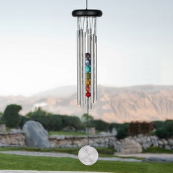Woodstock Seven Stones Chakra 17.5 Inch Wind Chime - Designed with seven stones aligned in an ascending column in the center of the chime that represent the seven chakras aligned along the human spine the Woodstock Seven Stones Chakra 17.5 Inch Wind Chime is a beautiful combination of sound and color. With six silver tubes finished with anodized aluminum that does not rust and black finish ash wood this wind chime is a beautiful addition to any home.Woodstock Percussion Wind Chimes are tuned using a computerized tuning process in order to achieve incomparably beautiful sound. These wind chimes also use an ancient tuning system known as just intonation. Because these notes fall between the notes of a piano (which is tuned using the modern equal temperament system) the chime has a unique authentic quality. The frequencies at which the different tubes vibrate are integrally related thus producing the purest musical intervals. Once you hear the beautiful tones created by these magical chimes you will understand why they are so popular around the world.Wind Chime Length: The length of a wind chime is measured by the overall length of the chime (not tube length) - hanging hook to the end of the sail. This wind chime is 17.5 inches long overall. Hanger not included.About Woodstock ChimesCreated by professional musician Garry Kvistad Woodstock Chimes feature original and innovative designs that will add beauty and elegance to your home. Each chime has been tuned to create the purest most beautiful musical intervals. Kvistad incorporates tunings of scales from many different cultures throughout the world to create unique inspiring sounds and styles. It's easy to find the chime that's right for you at Woodstock home of the original precision-tuned wind chime.