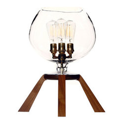 Glass Series No.4 - The Glass Series No.4 was an instant classic from the start and has become our No.1 selling piece.  Handblown glass that tapers into a solid wood plate with exposed leg joinery visible through the glass is one example of the attention to detail throughout this piece. A three cluster socket in your choice of finish is assembled from the finest UL listed components available and is standard with each piece thats made.