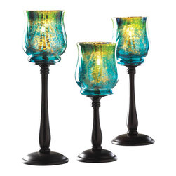 Malibu Creations - Malibu Creations Mediterranean Candleholder Trio - Texture, glow, color and style; this candle holder trio has it all. Shimmering shades of the warm Mediterranean will turn your tablescape into a sea of gorgeous glow when you place the candles of your choice inside these alluring accents. They feature teal, green and gold hues set in bubbles and waves of textured glass and mounted upon sleek spindles of dark metal, with varying heights to create a stunning collective display. With or without candles, the iridescent sheen of the candle cups will make all your evenings sparkle with style.