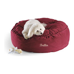 Frontgate - Pouf Pet Bed Dog Bed - High-loft fill for an extra-plush sleep surface. Removable cover is machine washable. Can be personalized with 10 letters. Our thick and fluffy Pouf Pet Bed is the next best thing to sleeping on a cloud. The bed's velvety polyester cover features a tufted top for extra comfort. The high-loft recycled fill holds its shape while still allowing your pet to sink into the softness.  .  .  . Please note: Personalized items are non-returnable.