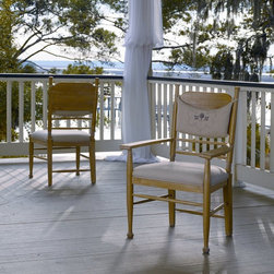 Paula Deen Home - Paula Deen Down Home Dining Side Chair - Oatmeal - Set of 2 Multicolor - UNIR132 - Shop for Dining Chairs from Hayneedle.com! The finishing touch on every one of Paula Deen's down-home recipes is the same - the Paula Deen Down Home Dining Side Chair - Oatmeal - Set of 2 a cozy casual Southern country-inspired chair that's the perfect place to settle in for a satisfying meal. Crafted with durable select hardwoods and poplar veneers this armless chair is finished in a pale oatmeal tone that softly highlights the high curved back and slanted legs. Decorative knobs finish the top and front legs. And a removable logo pillow slips over the back offering a little extra comfort - and perfectly coordinating with the plush neutral fabric seat. About Paula DeenSouthern cooking queen Paula Deen is known to millions as a popular TV show cooking host on the Food Network as well as a bestselling author. The Georgia native parlayed a home-based meal delivery service into her successful Lady and Sons restaurant in Savannah Ga. In 2008 Deen partnered with Meyer Corporation to launch a line of signature cookware bakeware kitchen tools and accessories which are used by home cooks everywhere.
