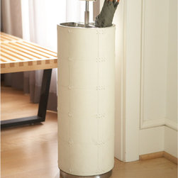 Umbrella Stand-Beige Leather - Round up those wayward umbrellas with this stylish leather umbrella stand.  Neutral in color, you can use this stand in your front entry, side entry or mudroom.  I like this unique take on the traditional umbrella stand.