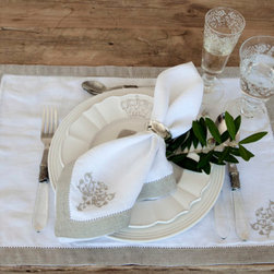 "Napkins and Placemats - The Lux placemats feature an embroidered design in the corner with a 1"" hemstitched flange. Use these placemats for entertaining to give your table setting a feeling of sophistication and with the simple design, they are sure to be used again and again. Pair with the Lux Linen Napkins for added elegance."