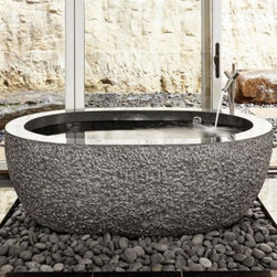 Oval Bathtub - Granite models feature polished interior and rim with chiseled exterior, while marble models are typically all polished.