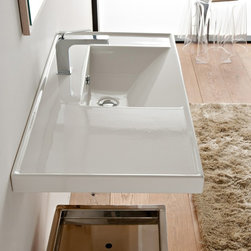 Scarabeo - Rectangular White Ceramic Self Rimming or Wall Mounted Bathroom Sink - Rectangular white ceramic self rimming or wall mounted sink. Stylish sink comes with overflow and no hole, one hole or three hole options. Made in Italy by Scarabeo. Made out of white ceramic. Contemporary design. Counter space on left side. Includes overflow. Standard drain size of 1.25 inches. ADA compliant. Because the sink has multiple installations, the back side is not glazed.