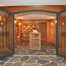 Traditional Wine Cellar by Blank & Baker Construction Management