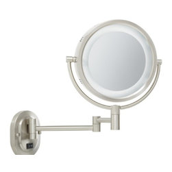 Jerdon HL65ND Hard-Wired 8-Inch Two-Sided Swivel Halo Lighted Wall Mount Mirror - The Jerdon HL65ND Hard-Wired 8-Inch Two-Sided Swivel Halo Lighted Wall Mount Mirror is used in luxury hotels and day spas because of its convenience, sleek look, lighting and magnification. This fog free, two-sided circular mirror has an 8-inch diameter and features a smooth 360-degree swivel design that provides 1x and 5x magnification options to make sure every detail of your hair and makeup are in place. The halo light design around the perimeter of the mirror and smooth rotation adjust to all angles for a dynamic point of view. This item can use the JPT25W replacement bulb (sold separately). An on/off rotary knob on the oval base will activate the halo lighting when you need it. The HL65ND has a mounting bracket that measures 4-inches by 5-inches and extends 14-inches from the wall and can be easily moved around, while still being firm enough to hold for odd angles. This mirror has an attractive matte nickel finish that protects against moisture and condensation and is designed to be wall mounted. This item comes complete with mounting hardware and is designed as a hard-wire only application (does not have a power cord or plug). The Jerdon HL65ND Hard-Wired 8-Inch Two-Sided Swivel Halo Lighted Wall Mount Mirror comes with a 1-year limited warranty that protects against any defects due to faulty material or workmanship. The Jerdon Style company has earned a reputation for excellence in the beauty industry with its broad range of quality cosmetic mirrors (including vanity, lighted and wall mount mirrors), hair dryers and other styling appliances. Since 1977, the Jerdon brand has been a leading provider to the finest homes, hotels, resorts, cruise ships and spas worldwide. The company continues to build its position in the market by both improving its existing line with the latest technology, developing new products and expanding its offerings to meet the growing needs of its customers.