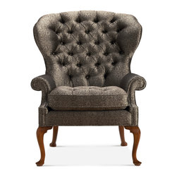 Baker Furniture - George II Wing Chair - This fine George II mahogany Wing Chair features an unusually rounded and flared back support in a deep button tuft.The fitted upholstered seat is flanked by scrolling arm supports. The chair rests on shaped cabriole legs that terminate to pad feet. Shown here in the Brandy finish, the chair is offered in any of the twenty Baker finishes. English c. 1750.